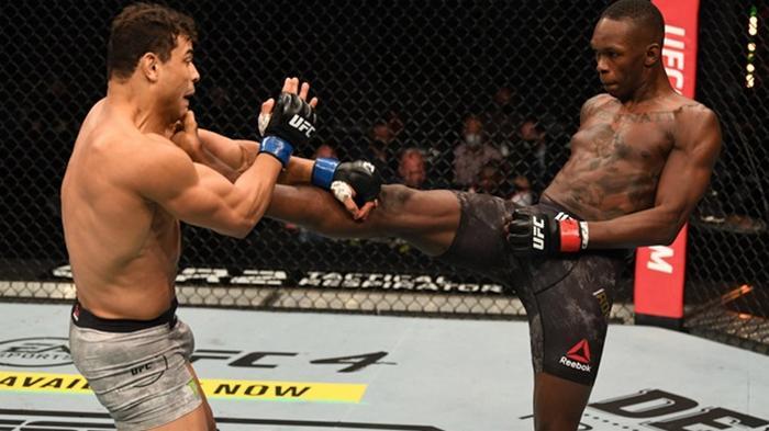 Адесанья защитил титул UFC, оставшись непобежденным